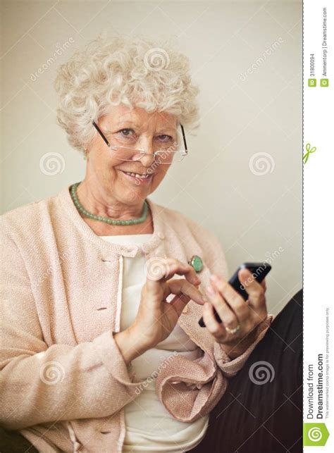 Old Lady Using Her Cellphone To Text Stock Images - Image
